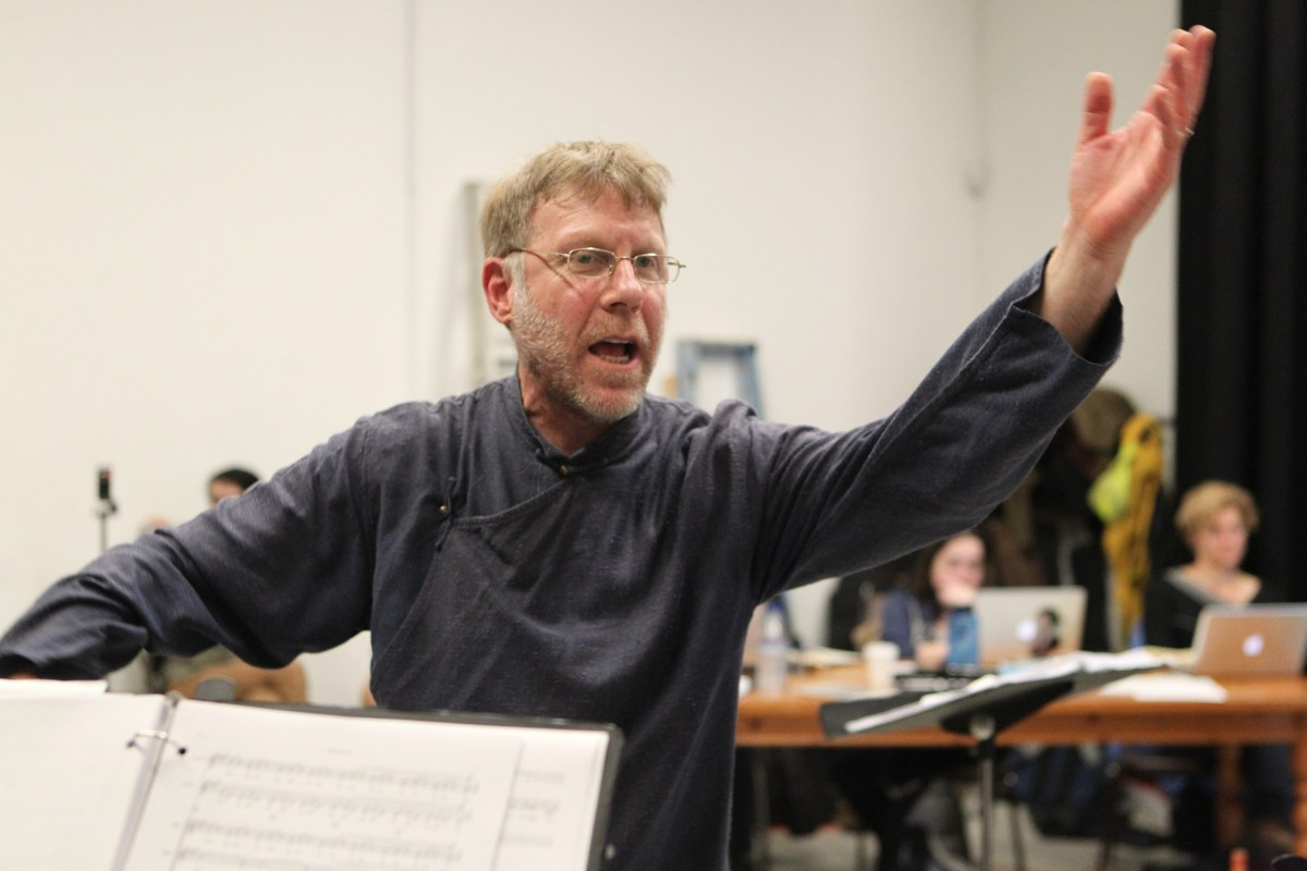 Yuval Ron directs the music. Photo by Michael Fox.