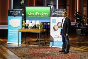 bernstein stands with promotional materials for his MealEnders product