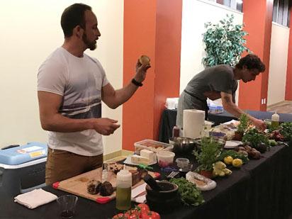 Pinchasi at a table preparing food