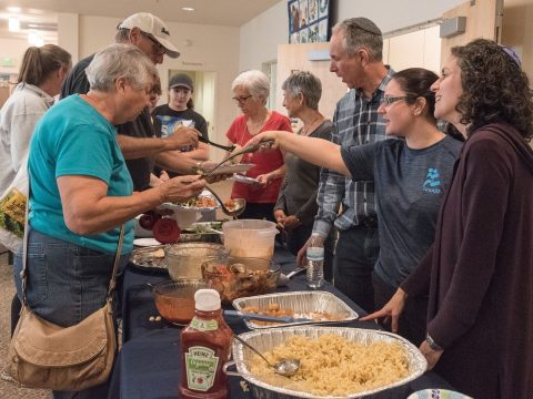 (From right) Kol Shofar Rabbi Chai Levy and Shomrei Torah Rabbis Stephanie Kramer and George Gittleman serve food to Carol Spear (turquoise shirt), who lost her Santa Rosa home in the fire, at Congregation Shomrei Torah in Santa Rosa, Oct. 11. (Photo/Norm Levin)