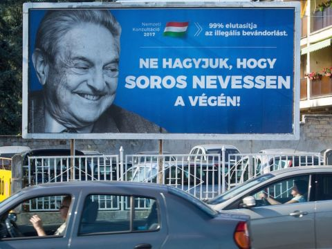 "A poster against U.S. billionaire George Soros in Szekesfehervar, Hungary, says, ""Don't let him have the last laugh,"" July 6, 2017. (JTA/Attila Kisbenedek/AFP/Getty Images)"