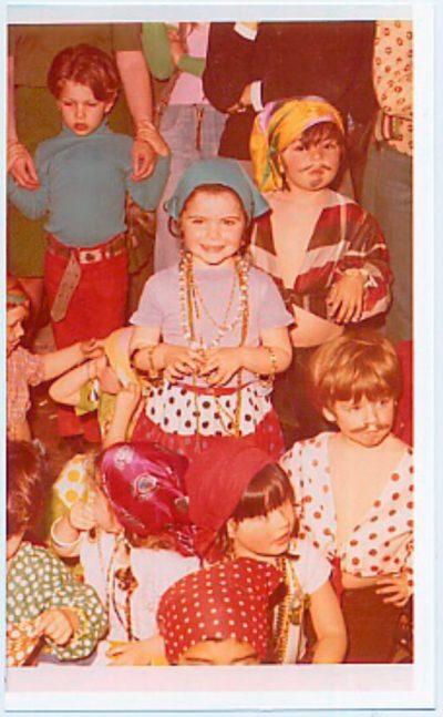 Monica Nainsztein at age 3, wearing a green kerchief, in one of the only photographs that survived her exile from Argentina.