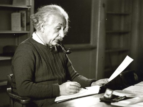 Albert Einstein in his office, at Princeton University, 1942 by Roman Vishniac