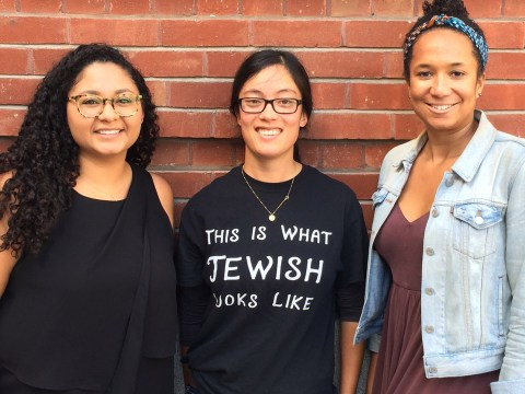 "Three teens stand together — one Latina, one Asian, one black — the Asian one is wearing a t-shirt that reads ""This is what Jewish looks like."""