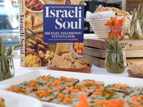 "cover of ""Israeli Soul"" on a table surrounded by food"