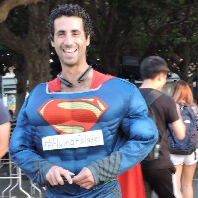 Flying Falafel owner Assaf Pashut dresses up as Superman at a Flying Falafel event.