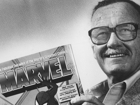 """Stan Lee poses with a book of """"Spider Man"""" comics in 1991. Along with Spider Man, Lee created characters such as Iron Man, Thor and The Incredible Hulk. (Photo/Gerald Martineau-The Washington Post via Getty Images)"""