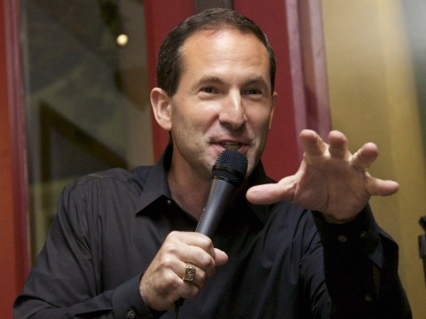 A man speaks into a microphone