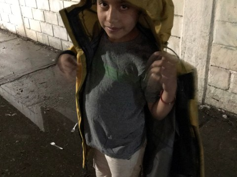 12-year-old Jose Arturo wears raincoat donated to him by the author.