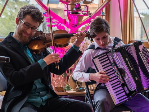 (From left) Matthew Stein and Dmitri Gaskin of Baymele, a klezmer-Yiddish trio, at a recent performance (Photo/Ryan Gourley)