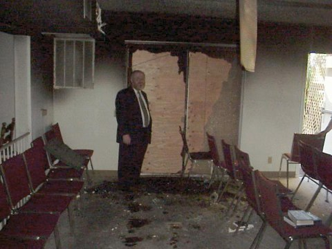Rabbi Stuart Rosen of Kenesset Israel Torah Center surveys damage after June 1999 firebombing (Photo/Courtesy Kenesset Israel Torah Center)