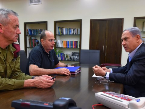 Prime Minister Benjamin Netanyahu confers with Gen. Benny Gantz (left) Defense Minister Moshe Yaalon during the 2014 Gaza War. Gantz and Yaalon are now running against Netanyahu in the Israeli election, but they may all be forced to share power once it's over. (Photo/JTA-Ariel Harmoni-Getty Images)