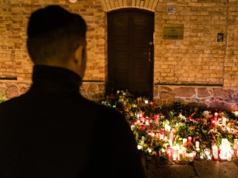 A man views a makeshift memorial at the entrance to the synagogue in Halle, Germany, Oct. 10, 2019. (Photo/JTA-Jens Schlueter-Getty Images)
