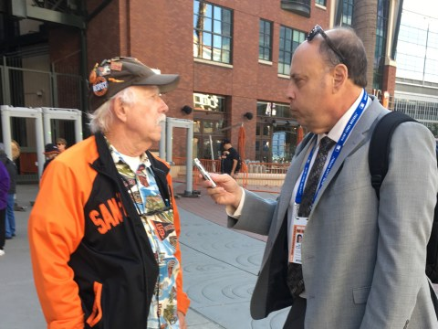 Henry Schulman interviewing a man outside of Oracle Park in January before Willie McCovey's public memorial. /Courtesy Henry Schulman