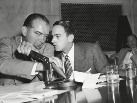 Sen. Joseph McCarthy covers his microphone to listen to his chief counsel, Roy Cohn. (Photo/Courtesy Mill Valley Film Festival)