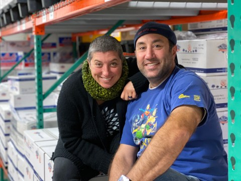 Sibling team Bonnie and Schecky Miluso sitting on boxes of figs and almonds in the Napa Nuts warehouse. (BRENT AUGUSTINE)