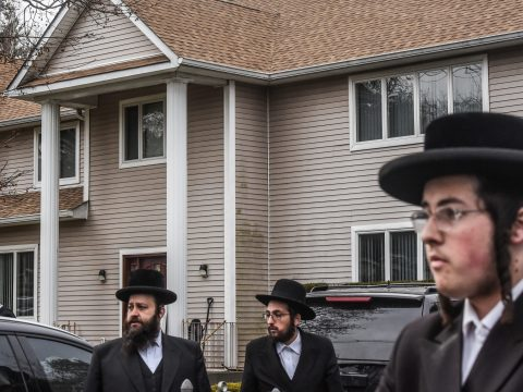 People gather in front of the Monsey house of Rabbi Chaim Rottenberg, the site of an attack at a Hanukkah party by a machete-wielding man, Dec. 29, 2019. (JTA/Stephanie Keith/Getty Images)