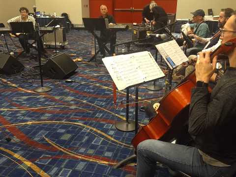Members of the Reform Biennial Friday night service band practice in Chicago, Dec. 12, 2019. Josh Nelson, the biennial's artistic director, is at left. (JTA/Ben Sales)