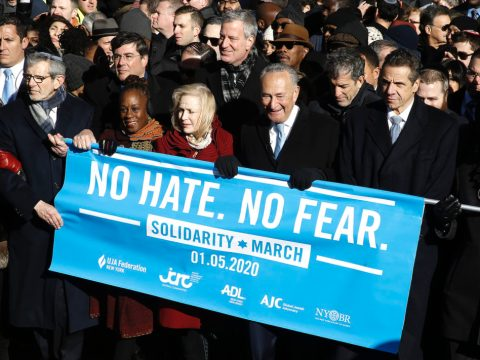 (From right) Rep. Jerrold Nadler, Gov. Andrew Cuomo, Sen. Chuck Schumer, Mayor Bill de Blasio and Sen. Kirsten Gillibrand hold a banner at the march against anti-Semitism in New York City, Jan. 5, 2020. (JTA/John Lamparski/Echoes Wire/Barcroft Media via Getty Images)