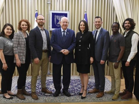 Israeli President Reuven Rivlin (center) is flanked by Passages co-founder Ruth Kidron and Executive Director Scott Phillips, fourth from right, along with program participants, who presented Rivlin with a Hebrew Bible. (JTA/Mark Neyman/Israel Government Press Office)