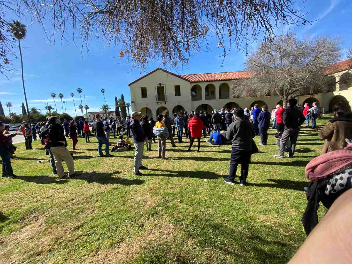 Evacuees at March Air Reserve Base in Riverside County stand in the base's courtyard. (Esther Tiferes Tebeka)