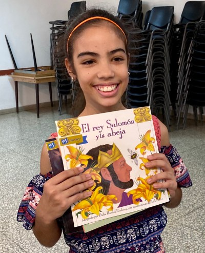 A Jewish Cuban girl with a new PJ Library book.