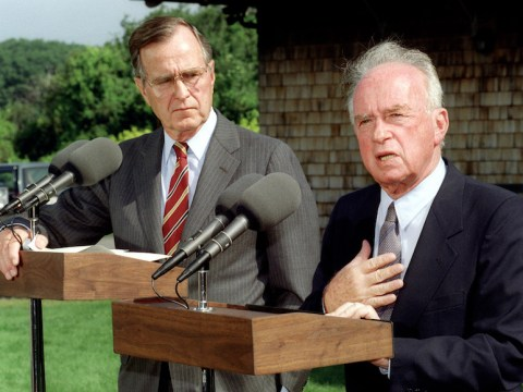 President George H.W. Bush listens to Israeli Prime Minister Yitzhak Rabin answer questions at a joint press conference, Aug. 11, 1992. (JTA/Paul J. Richards/AFP/Getty Images)