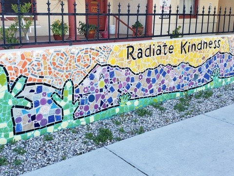 Mosaic decorating one of the walls outside Casa Alitas, a migrant shelter in Tucson. (Margaret Johnson)