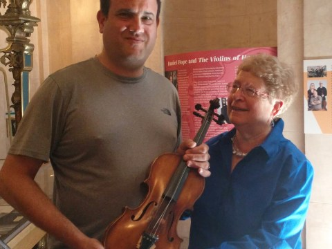 Avshi Weinstein and Marsha Cohen with her father's violin. (PATRICIA KRISTOF MOY)