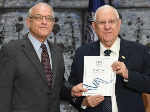 Israel's President Reuven Rivlin receives the final official results of the March 2 national election from Central Elections Committee Chairman Neal Hendel on March 11, 2020, at the President's Residence in Jerusalem. (JTA/MARK NEYMAN/GPO)