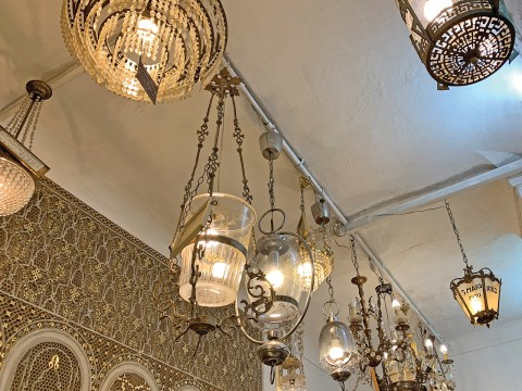 The lamps and chandeliers at Synagogue Roben Bensadoun in Fez are relics from old synagogues in the city's Jewish quarter, or mellah. (SUE BARNETT)