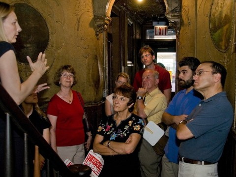 A group takes a tour of the Tenement Museum, which tells the stories of Jewish and other immigrants to New York, in 2008. The museum has closed temporarily and shedded most of its staff. (JTA/KIKO NIWA)