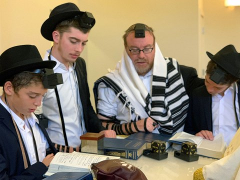 Rabbi Shlomo Zarchi of Congregation Chevra Thilim leads a bar mitzvah service for his twin sons on Dec. 19, 2019. (Photo/Courtesy Zarchi)