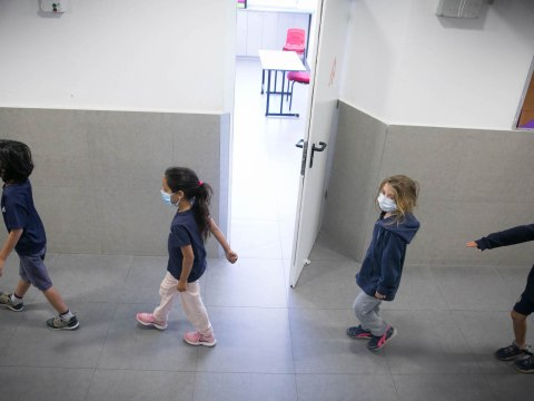 Israeli students at the Orot Etzion school in Efrat wear protective face masks as they return to school, May 3, 2020. (Photo/JTA-Gershon Elinon-Flash90)