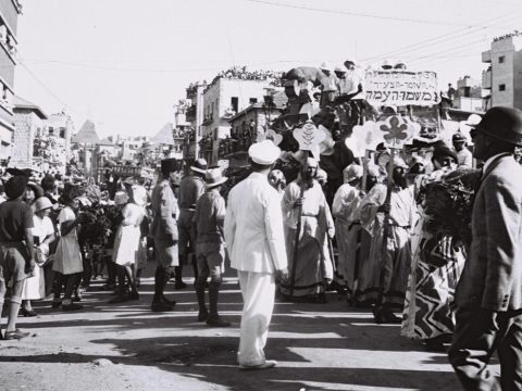"In 1933, 500 people paraded down the streets of Hadar HaCarmel. Nonetheless, it was described in the Tel Aviv press as lacking ""the joy of the Adloyada."" (Photo/GPO)"