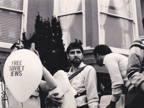 David Waksberg at a Simchat Torah rally for Soviet Jews in front of the San Francisco Soviet consulate in 1984 with son Raphael Bob-Waksberg on his chest. (Photo/Courtesy Waksberg)