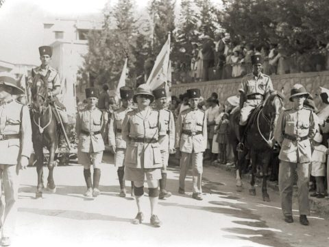 Jewish, Arab and British police officers lead the 1933 Bikurim parade in Haifa. (Photo/GPO via Wikipedia)