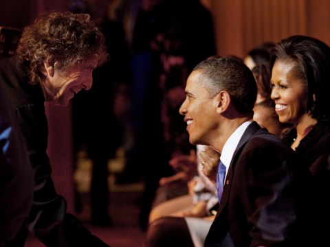 Bob Dylan shakes President Barack Obama's hand following his performance at the