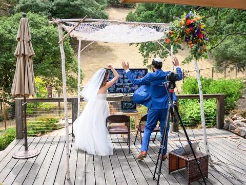 Miriam Nehama Ani and Brandon Waloff celebrate with virtual guests at their Zoom wedding, May 31, 2020. (Photo/Éli Zaturanski-Visage Studios)