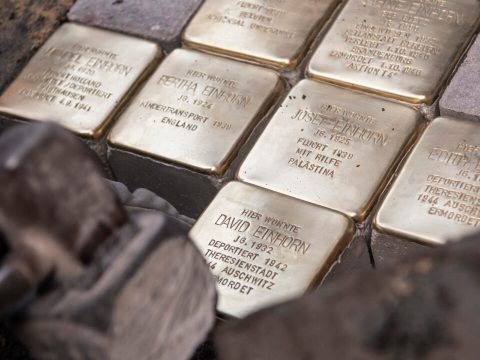 golden paving stones with names of Jewish Germans embedded in the pavement