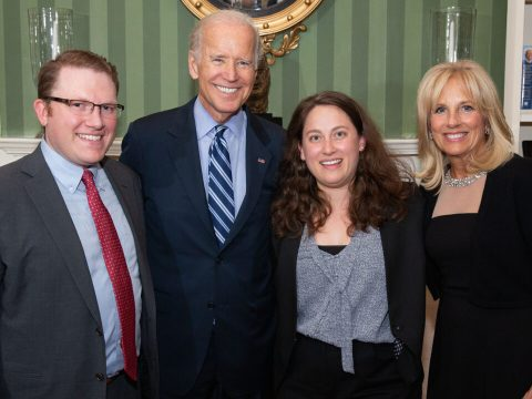 a white man in his 30s stands with Joe Biden, Jill Biden and a white woman in her 30s. all are smiling.