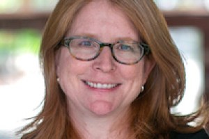 Portait of Daisy Pellant, the new head of Kehillah Jewish High School. She is 52, has red hair and glasses.