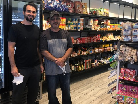 Son and father Gal and Yuval Atias remove their masks for a photo at Oakland Kosher's newly expanded space. (Photo/Alix Wall)