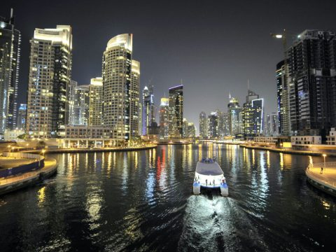 A boat crosses a sound in Dubai, United Arab Emirates. (Photo/Andia-Universal Images Group via Getty Images)