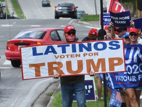 People hold placards after U.S. Vice President Mike Pence addressed supporters at a Latinos for Trump campaign rally at Central Christian University in Orlando, Florida, Oct. 10, 2020. (Photo/JTA-Paul Hennessy-NurPhoto via Getty Images)