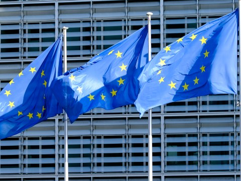 three EU flags blow in the wind
