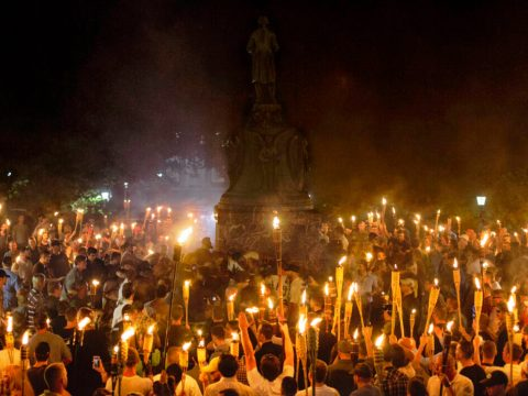 Neo-Nazis and white supremacists encircle counterprotesters at the base of a statue of Thomas Jefferson after marching through the University of Virginia campus with torches in Charlottesville, Va., Aug. 11, 2017. (Photo/JTA-Shay Horse-NurPhoto via Getty Images)