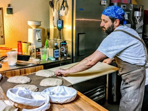 Adam Brelow making bread. (Photo/Maharat Victoria Sutton)