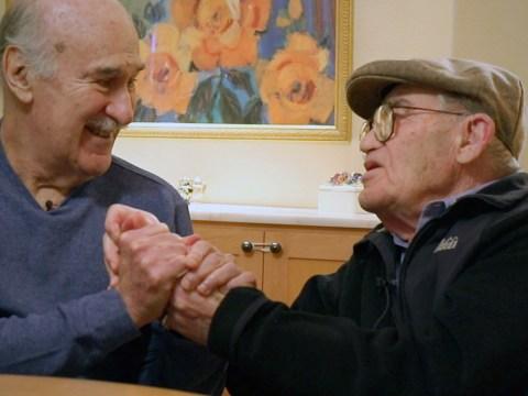 Holocaust survivor and activist Ben Stern locks hands with Glasser.