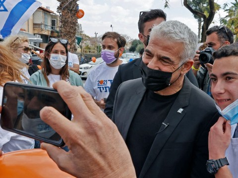Lapid, now the chairman of Israel's opposition party Yesh Atid, campaigns in the coastal Mediterranean city of Hod Hasharon, March 19, 2021. (Photo/JTA-Jack Guez-AFP via Getty Images)